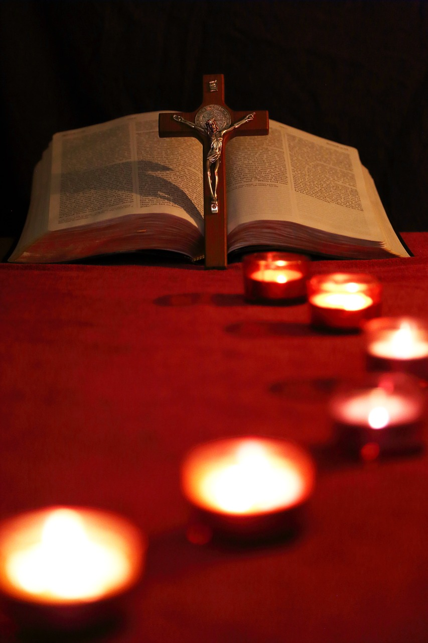 candles, bible, and crucifix