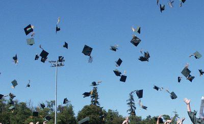 graduates tossing caps
