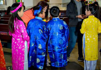 Children at a Vietnamese service